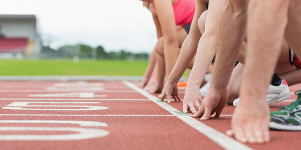 People ready to race on track field