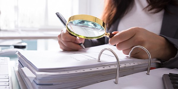 Magnifying glass over documents