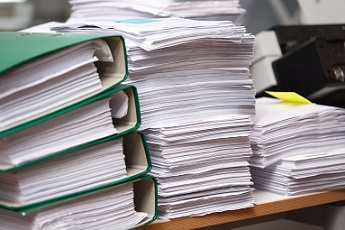 papers stacked on desk